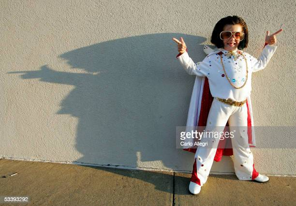 Kelsie Gaddis poses for a photo before a candle light vigil to mark the 28th anniversary of Elvis Presley's death during Elvis Week 2005 August 15...