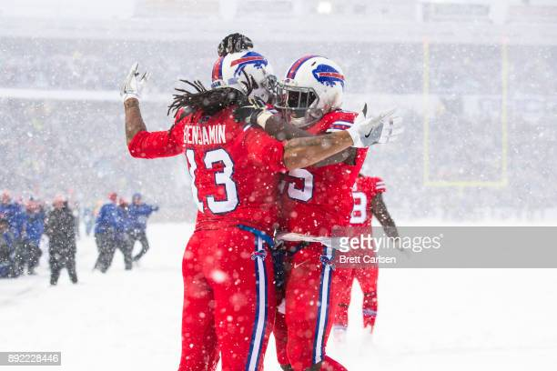 Kelvin Benjamin celebrates a touchdown reception with teammate LeSean McCoy of the Buffalo Bills during the second quarter against the Indianapolis...