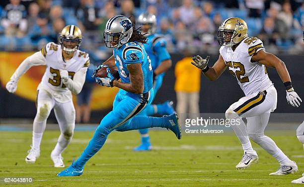 Kelvin Benjamin of the Carolina Panthers catches a pass against Craig Robertson of the New Orleans Saints in the third quarter during the game at...