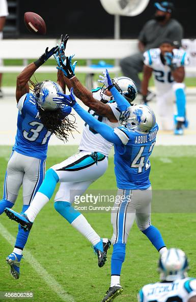 Kelvin Benjamin of the Carolina Panthers goes up for a pass against Rashean Mathis and Isa AbdulQuddus of the Detroit Lions at Bank of America...