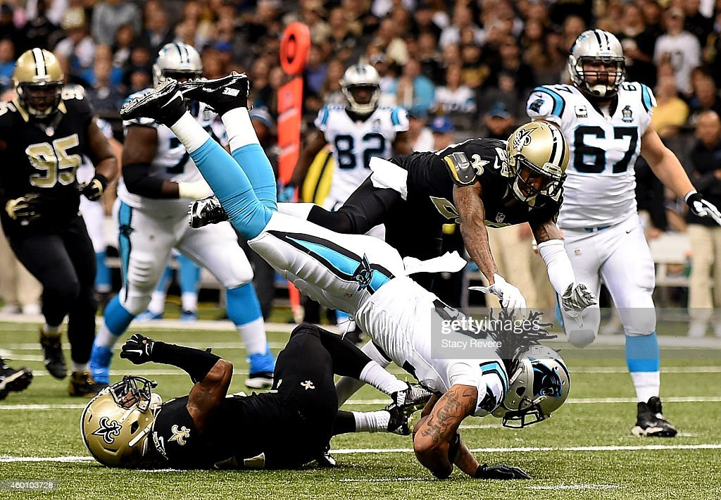 Kelvin Benjamin #13 of the Carolina Panthers scores a touchdown as Pierre Warren #42 of the New Orleans Saints tries turnover defend during the first quarter at Mercedes-Benz Superdome on December 7, 2014 in New Orleans, Louisiana.