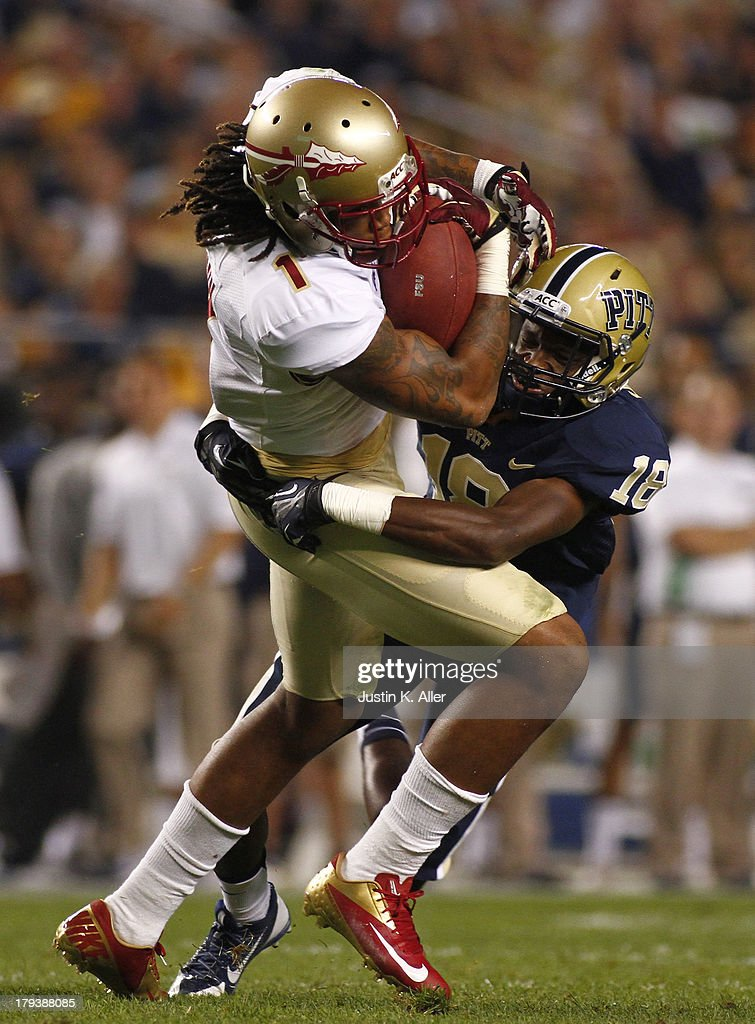Kelvin Benjamin #1 of the Florida State Seminoles makes a catch in the first half against Titus Howard #18 of the Pittsburgh Panthers during the game on September 2, 2013 at Heinz Field in Pittsburgh, Pennsylvania.