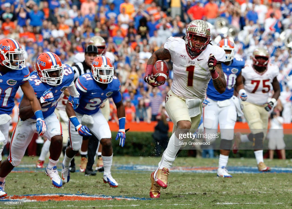 Kelvin Benjamin of the Florida State Seminoles runs for yardage during the game against the Florida Gators on November 30 2013 in Gainesville Florida