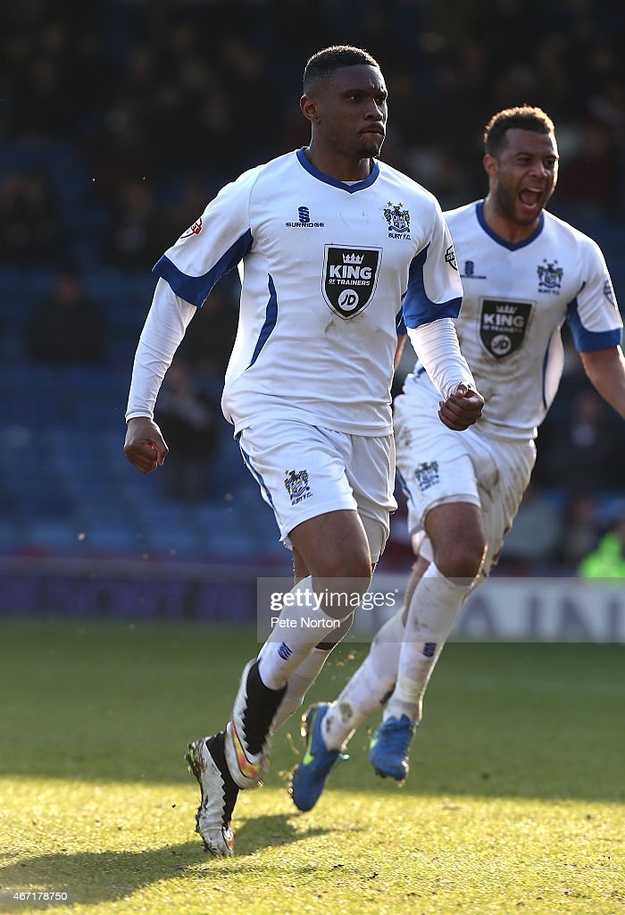 Kelvin Ethuhu of Bury celebrates after scoring his sides 1st goal during the Sky Bet League Two match between Bury and Northampton Town at The JD...