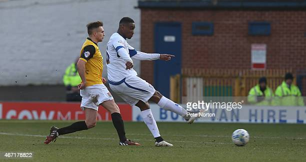 Kelvin Ethuhu of Bury has a shot at goal to score his sides 1st goal during the Sky Bet League Two match between Bury and Northampton Town at The JD...