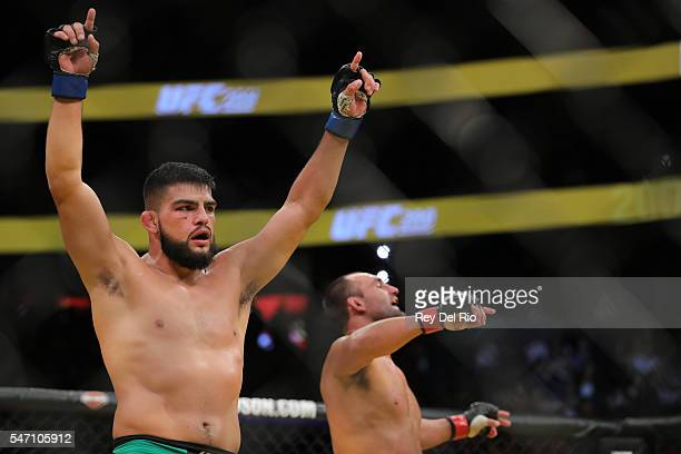 Kelvin Gastelum celebrates after his fight against Johny Hendricks during the UFC 200 event at TMobile Arena on July 9 2016 in Las Vegas Nevada