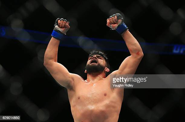 Kelvin Gastelum of the United States celebrates victory over Tim Kennedy of the United States in their Middleweight bout during the UFC 206 event at...