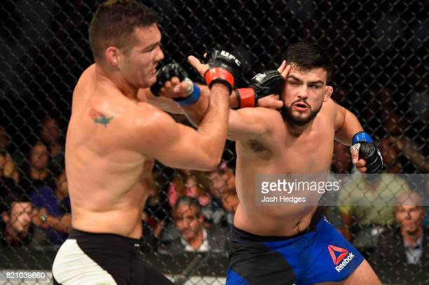 Kelvin Gastelum punches Chris Weidman in their middleweight bout during the UFC Fight Night event inside the Nassau Veterans Memorial Coliseum on...
