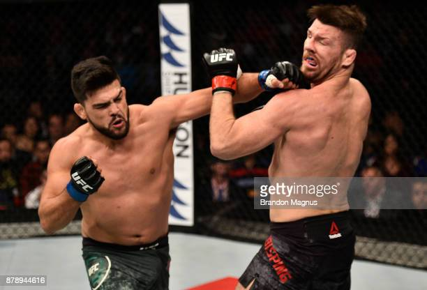 Kelvin Gastelum punches Michael Bisping of England in their middleweight bout during the UFC Fight Night event inside the MercedesBenz Arena on...