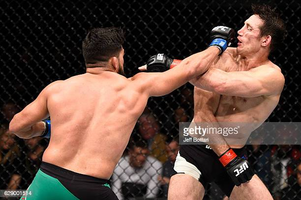 Kelvin Gastelum punches Tim Kennedy in their middleweight bout during the UFC 206 event inside the Air Canada Centre on December 10 2016 in Toronto...