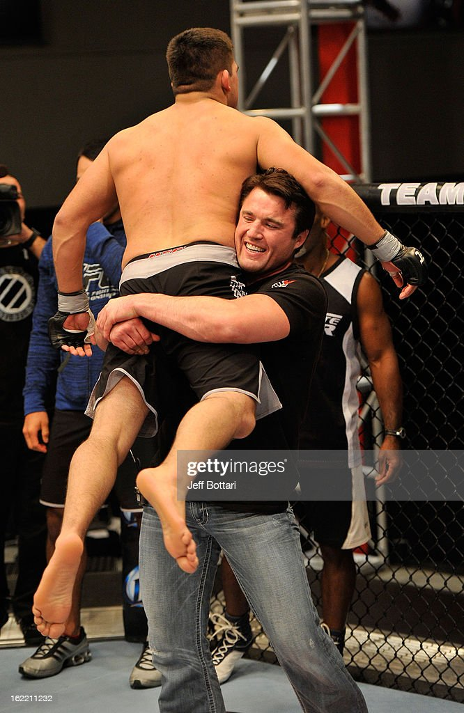 Kelvin Gastelum (L) reacts with coach <a gi-track='captionPersonalityLinkClicked' href=/galleries/search?phrase=Chael+Sonnen&family=editorial&specificpeople=5434559 ng-click='$event.stopPropagation()'>Chael Sonnen</a> (R) after defeating Robert 'Bubba' McDaniel in their preliminary fight during filming for season seventeen of The Ultimate Fighter at the UFC Training Center on November 9, 2012 in Las Vegas, Nevada.