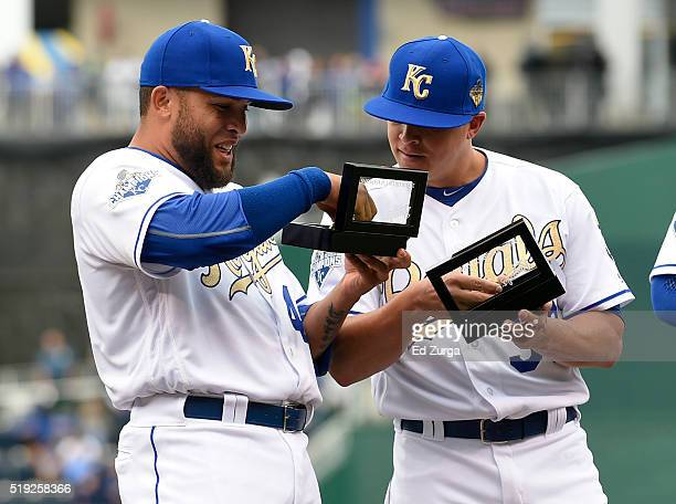 Kelvin Herrera and Kris Medlen of the Kansas City Royals look at their World Series Championship ring during a ceremony prior to a game against the...