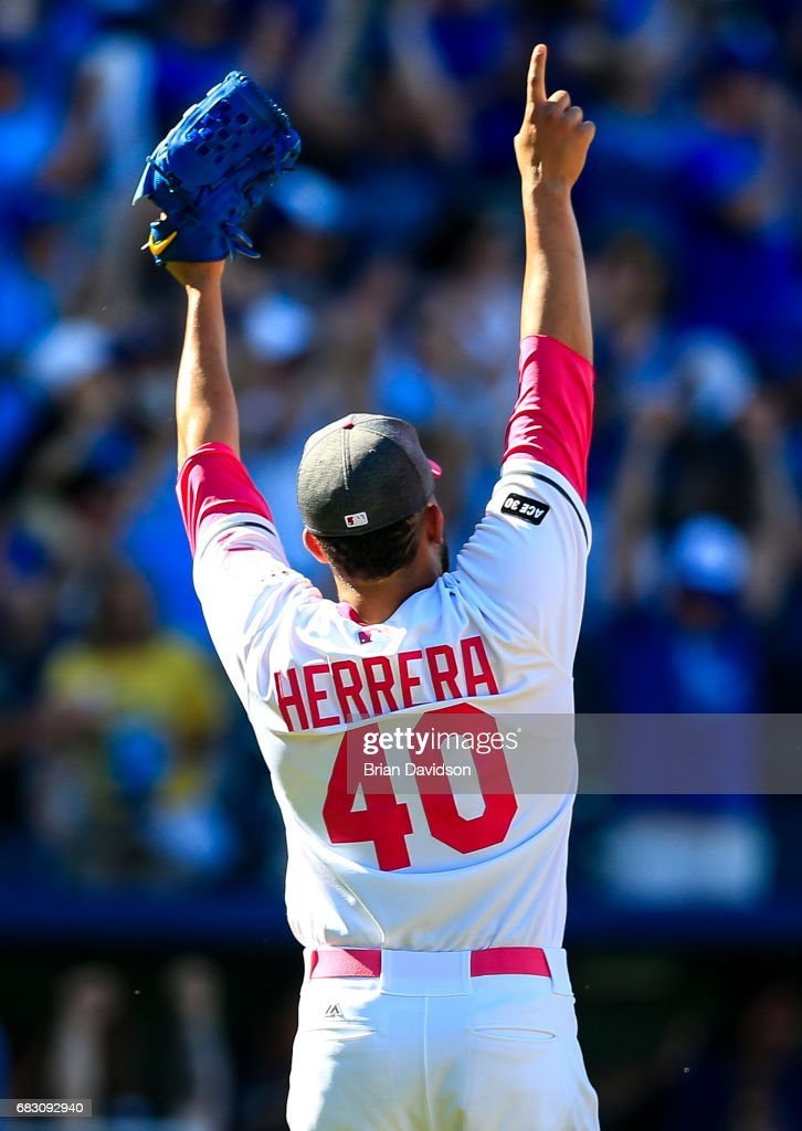 Kelvin Herrera #40 of the Kansas City Royals celebrates the Royals defeating the Baltimore Orioles 9-8 at Kauffman Stadium on May 14, 2017 in Kansas City, Missouri. Players are wearing pink to celebrate Mother's Day weekend and support breast cancer awareness.