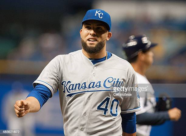 Kelvin Herrera of the Kansas City Royals smiles as he walks off the field after pitching against the Tampa Bay Rays August 28 2015 at Tropicana Field...