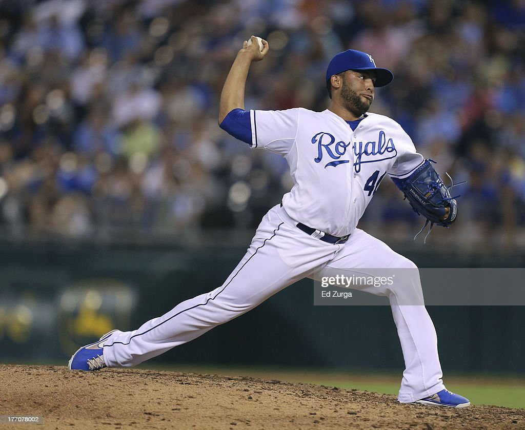 Kelvin Herrera #40 of the Kansas City Royals throws in the eighth inning during a game against the Chicago White Sox at Kauffman Stadium August 20, 2013 in Kansas City, Missouri.