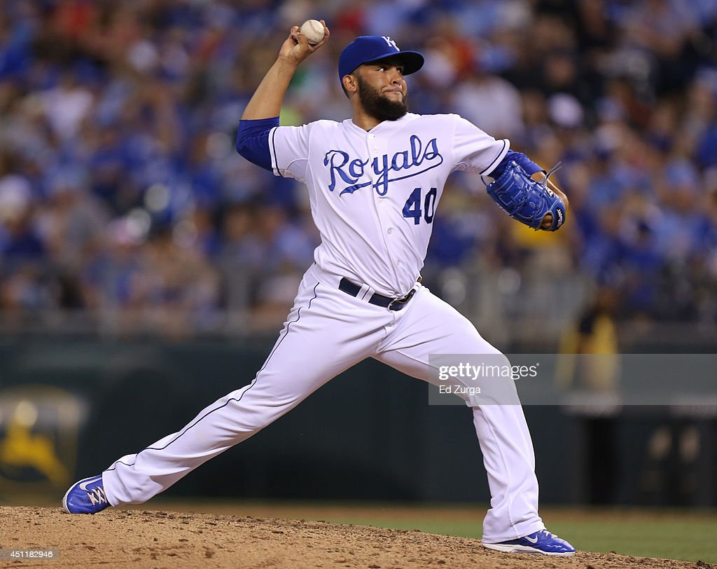 Kelvin Herrera #40 of the Kansas City Royals throws in the eighth inning against the Los Angeles Dodgers at Kauffman Stadium on June 24, 2014 in Kansas City, Missouri.