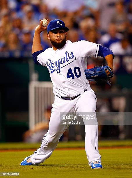 Kelvin Herrera of the Kansas City Royals throws out Eduardo Escobar of the Minnesota Twins during the 7th inning of the game at Kauffman Stadium on...
