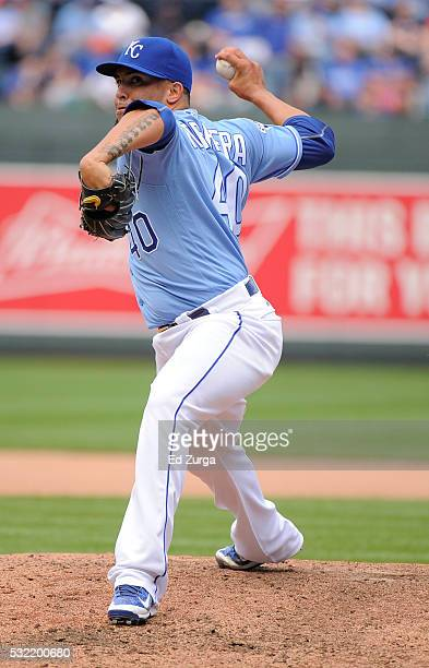 Kelvin Herrera of the Kansas City Royals warms up before throwing against the Boston Red Sox in the seventh inning during the first game of a...
