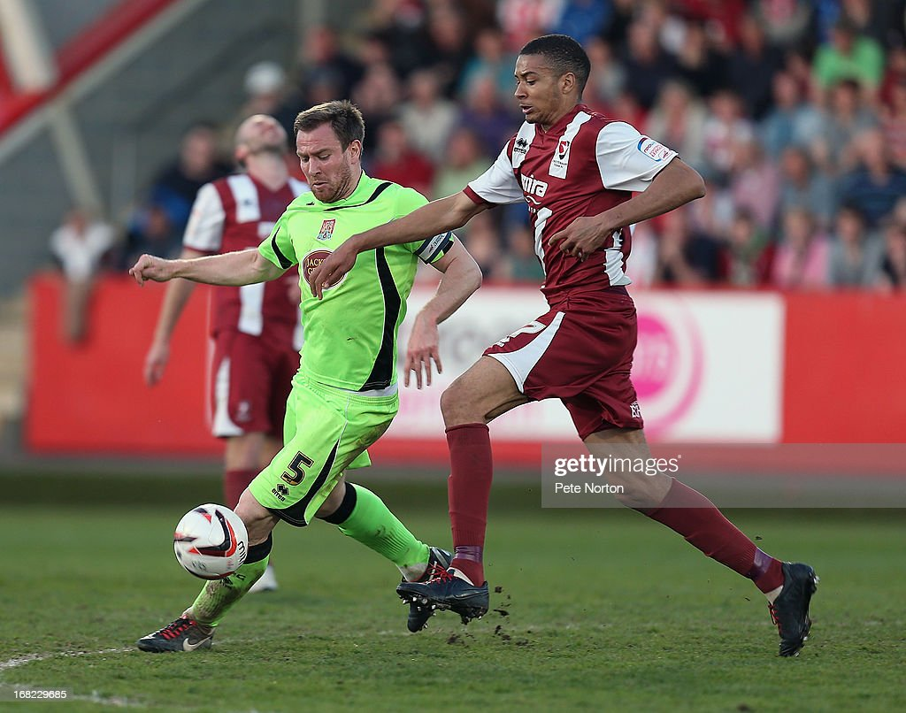 Kelvin Langmead (L) of Northampton Town contests the ball with Michael Hector of Cheltenham Town during the npower League Two Play Off Semi Final Second Leg between Cheltenham Town and Northampton Town at Abbey Business Stadium on May 5, 2013 in Cheltenham, England.
