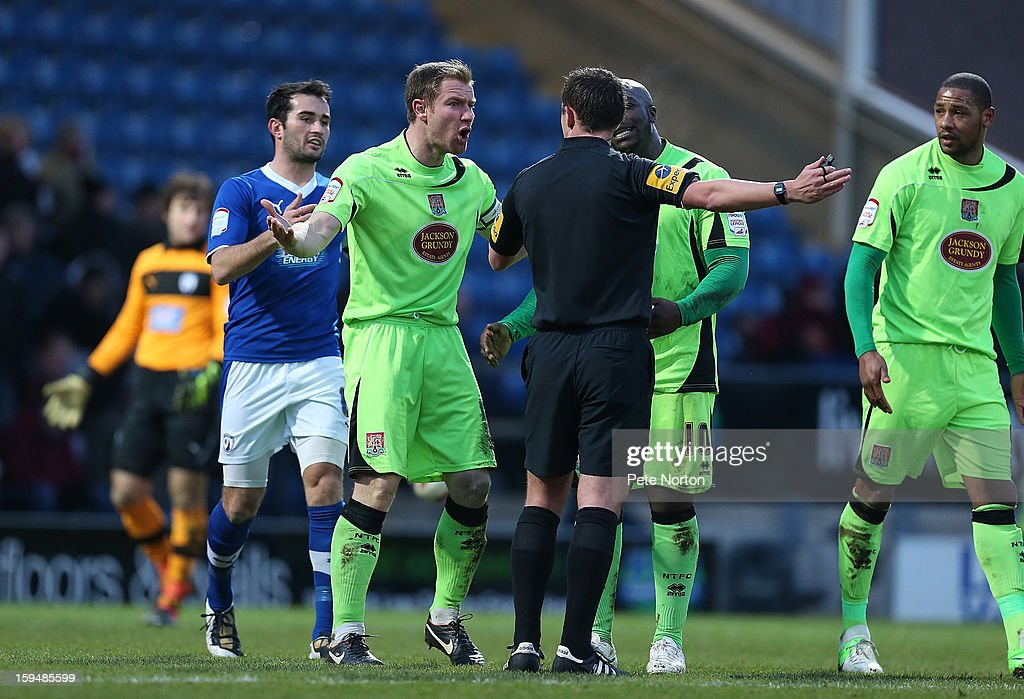 Kelvin Langmead of Northampton Town makes a point to referee Stuart Atwell during the npower League Two match between Chesterfield and Northampton Town at the Proact Srtadium on January 12, 2013 in Chesterfield, England.