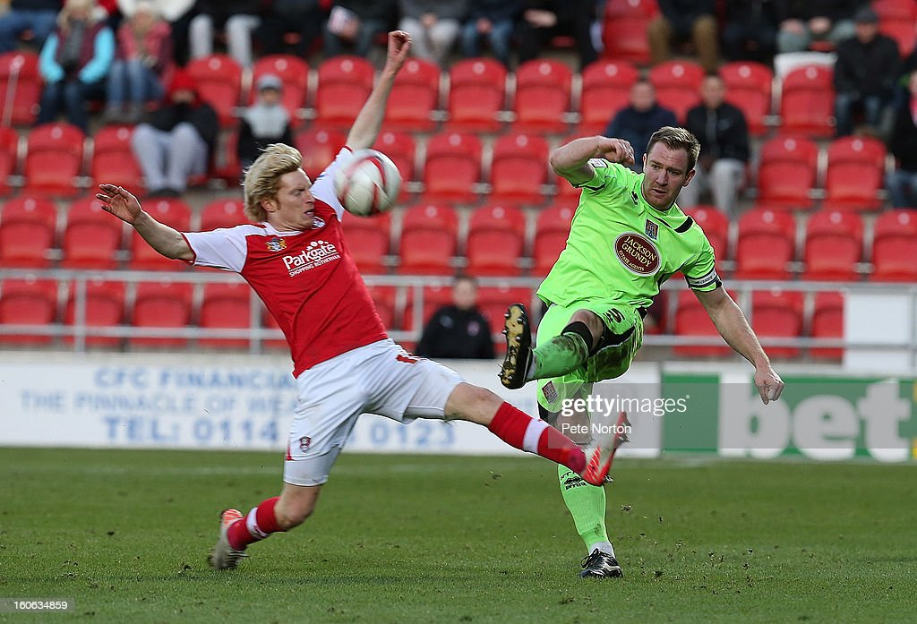 Kelvin Langmead (R) of Northampton Town plays the ball past Ben Pringle of Rotherham United during the npower League Two match between Rotherham United and Northampton Town at New York Stadium on February 2, 2013 in Rotherham, England.