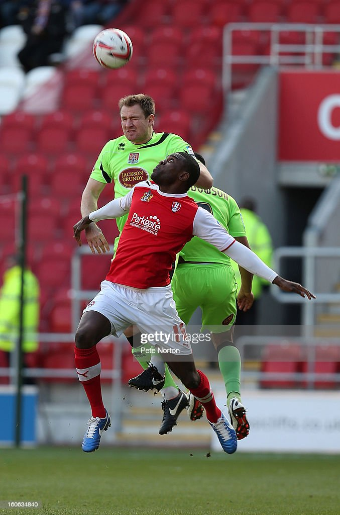 Kelvin Langmead (L) of Northampton Town rises above Kayode Odejayi of Rotherham United to head the ball during the npower League Two match between Rotherham United and Northampton Town at New York Stadium on February 2, 2013 in Rotherham, England.