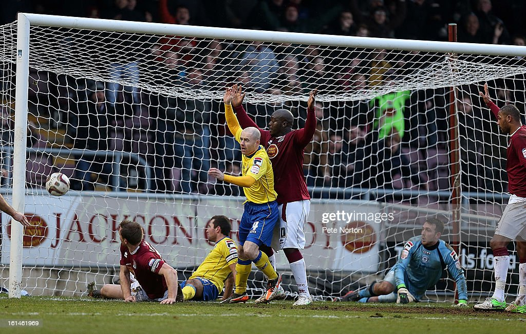 Kelvin Langmead (L) of Northampton Town scores his sides 2nd goal during the npower League Two match between Northampton Town and Rochdale at Sixfields Stadium on February 9, 2013 in Northampton, England.