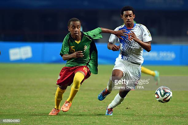 Kelvin of Cape Verde Islands battles with Jules Bororoa of Vanuatu during the 2014 FIFA Boys Summer Youth Olympic Football Tournament Preliminary...