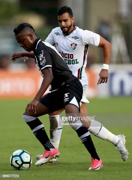 Kelvin of Vasco struggles for the ball with Henrique Dourado of Fluminense during a match between Vasco and Fluminense part of Brasileirao Series A...