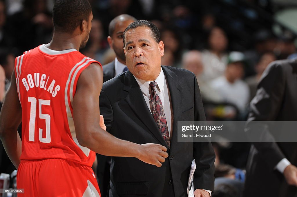 Kelvin Sampson assistant coach of the Houston Rockets speaks with Toney Douglas #15 during the game against the Denver Nuggets on January 30, 2013 at the Pepsi Center in Denver, Colorado.