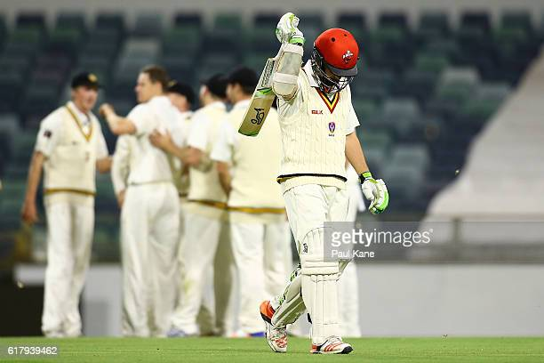 Kelvin Smith of the Redbacks walks back to the rooms after being dismissed by Jason Behrendorff of the Warriors during day one of the Sheffield...