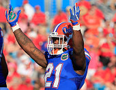 Kelvin Taylor of the Florida Gators celebrates a touchdown during the game against the Georgia Bulldogs at EverBank Field on October 31 2015 in...