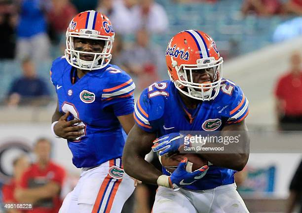 Kelvin Taylor of the Florida Gators rushes for yardage during the game against the Georgia Bulldogs at EverBank Field on October 31 2015 in...
