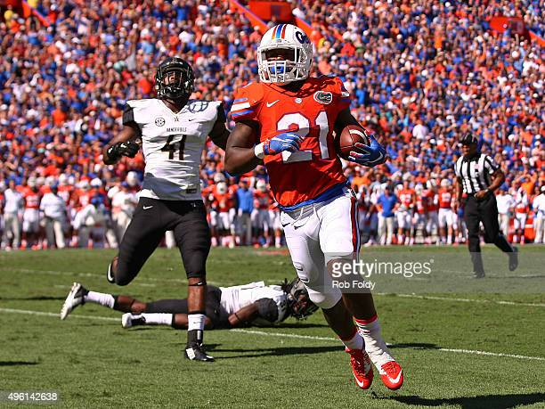 Kelvin Taylor of the Florida Gators scores a touchdown during the first quarter of the game against the Vanderbilt Commodores at Ben Hill Griffin...