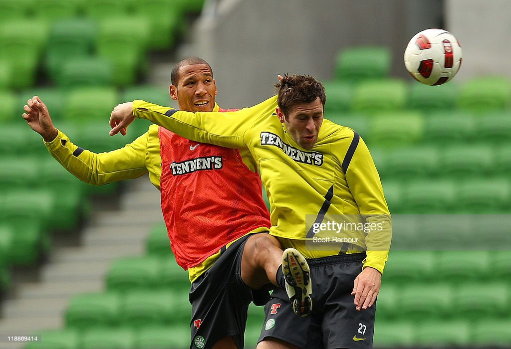Kelvin Wilson and Daryl Murphy (R) of Celtic compete for the ball during a Glasgow Celtic training session at AAMI Park on July 12, 2011 in Melbourne, Australia.