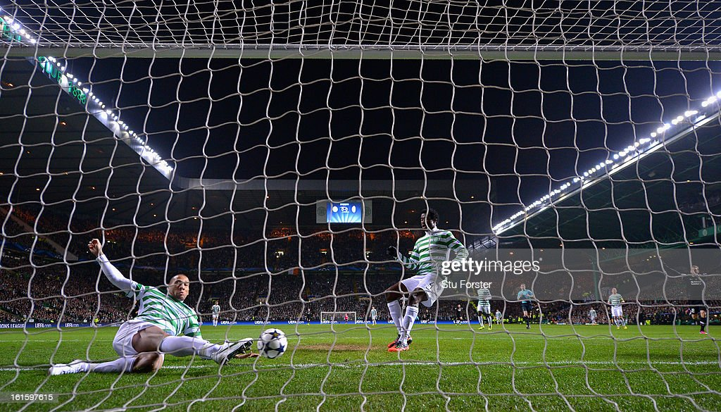 Kelvin Wilson of Celtic fails to keep out the first goal scored by Alessandro Matri of Juventus during the UEFA Champions League Round of 16 first leg match between Celtic and Juventus at Celtic Park Stadium on February 12, 2013 in Glasgow, Scotland.