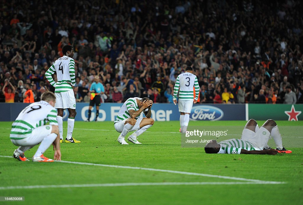 Kelvin Wilson (C) of Celtic FC sits dejected amid his teammates (L-R) James Forrest, Efe Ambrose, Emilio Izaguirre and Victor Wanyama after receiving a goal in overtime during the UEFA Champions League group G match between FC Barcelona and Celtic FC at the Camp Nou stadium on October 23, 2012 in Barcelona, Spain.