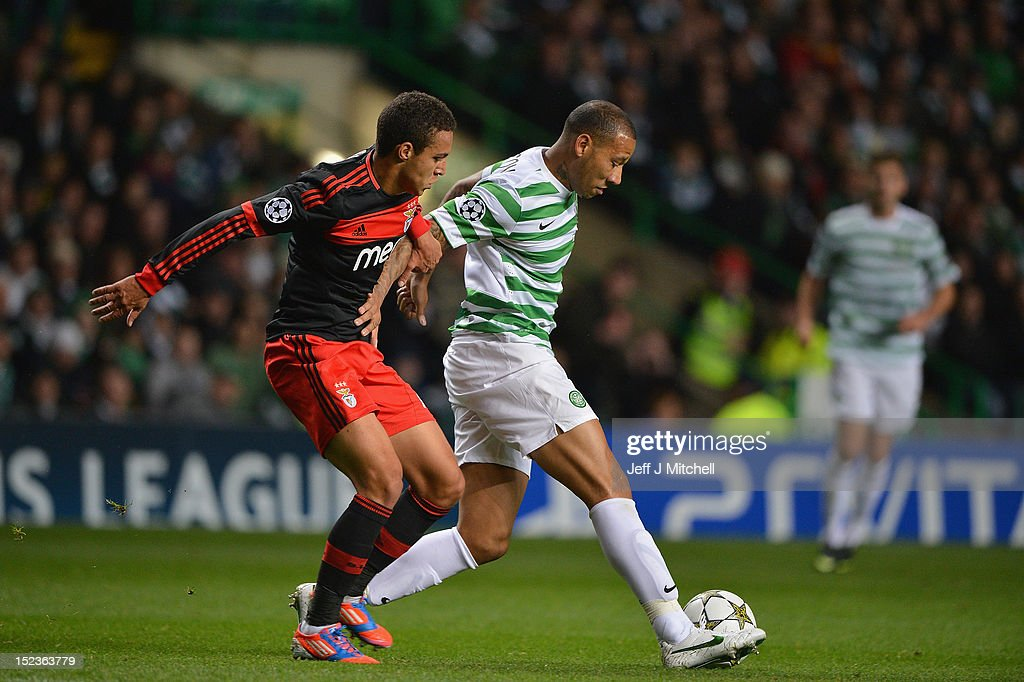 Kelvin Wilson of Celtic tackles Rodrigo of SL Benfica during the Champions League UEFA Champions League match between Celtic and SL Benfica at Celtic Park on September 19, 2012 in Glasgow,Scotland.