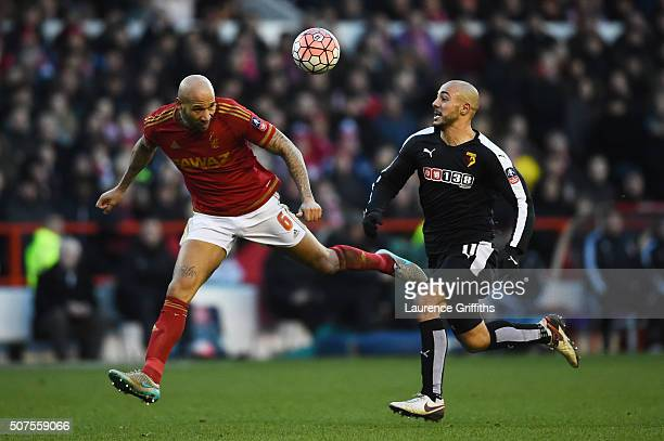 Kelvin Wilson of Nottingham Forest and Adlene Guedioura of Watford compete for the ball during The Emirates FA Cup fourth round between Nottingham...