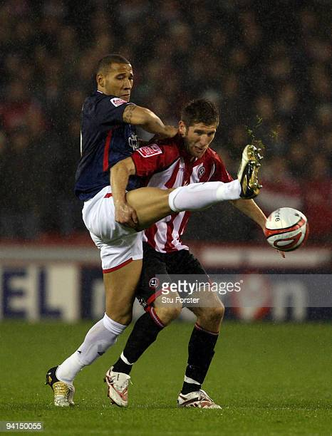 Kelvin Wilson of Nottingham Forest challenges United's forward Richard Cresswell during the CocaCola Championship game between Sheffield United and...