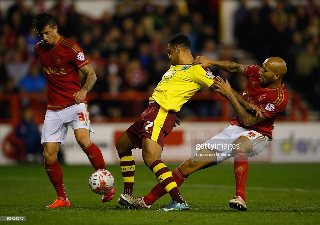 Kelvin Wilson of Nottingham Forest holds back Andre Gray of Burnley during the Sky Bet Championship match between Nottingham Forest and Burnley at City Ground on October 20, 2015 in Nottingham, England.