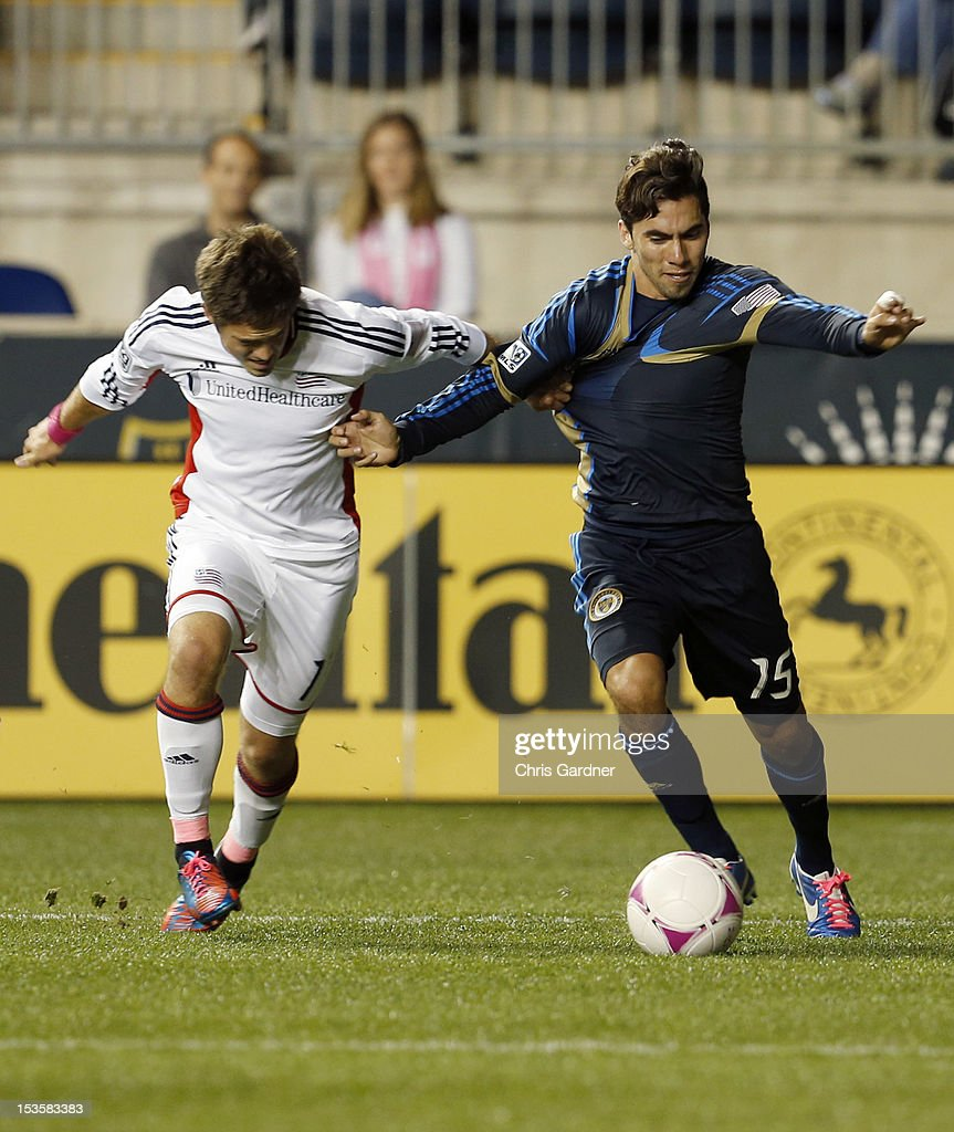 Kelyn Rowe #11of the New England Revolution tries to contain Gabriel Farfan #15 of the Philadelphia Union at PPL Park on October 6, 2012 in Chester, Pennsylvania.