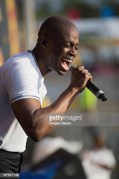 Kem Owens performs during the 2013 New Orleans Jazz Heritage Music Festival at Fair Grounds Race Course on May 2 2013 in New Orleans Louisiana