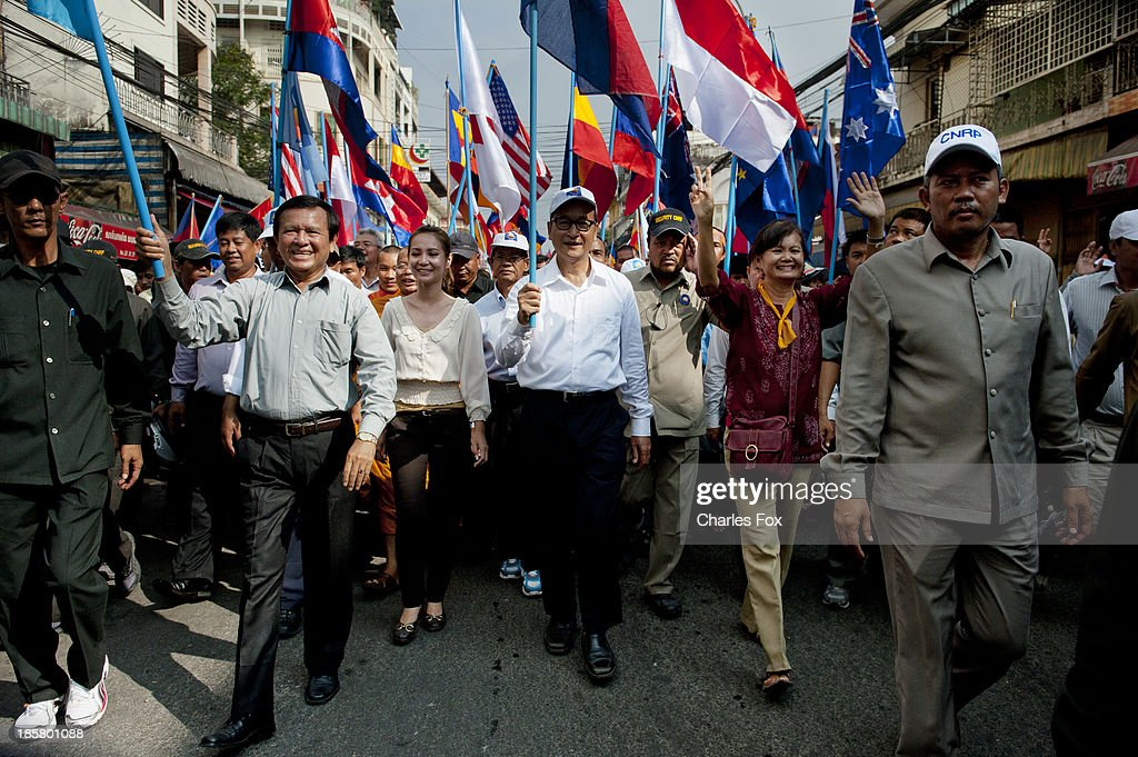 Kem Sokha Vice President, Sam Rainsy President, Mu Socha MP of the CNRP walk down street 51 with supporters of the CNRP on October 25, 2013 in Phnom Penh, Cambodia. Today is the last day of a three day protest held by the Cambodian National Rescue Party hold in commemoration of the 22nd anniversary of the October 23, 1991 Paris Peace Accords. The CNRP delivered letters to the Australian, Russian, Japanese, Indonesian and Chinese Embassies asking them to put pressure on the Cambodian government to resolve the current political deadlock caused by a dispute over the country's July elections.