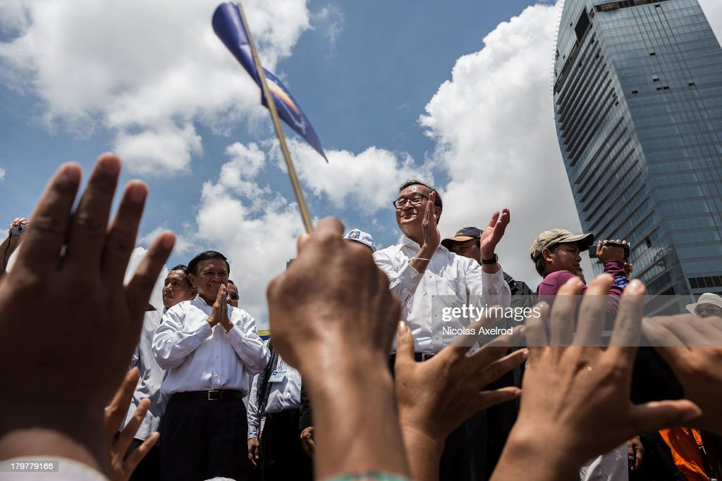 Kem Sokha VicePresident and Sam Rainsy President of the Cambodia National Rescue Party thanks supporters in Freedom Park on September 7 2013 in Phnom...
