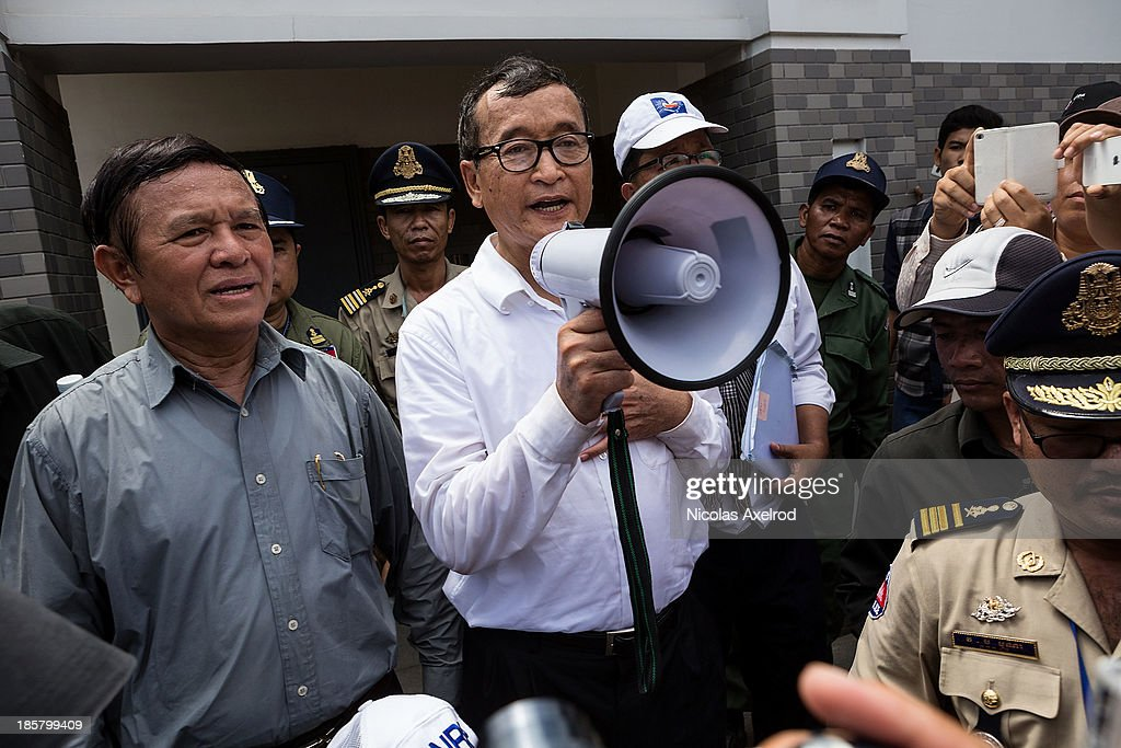 <a gi-track='captionPersonalityLinkClicked' href=/galleries/search?phrase=Kem+Sokha&family=editorial&specificpeople=659005 ng-click='$event.stopPropagation()'>Kem Sokha</a> (L), Vice-President of the CNRP and <a gi-track='captionPersonalityLinkClicked' href=/galleries/search?phrase=Sam+Rainsy&family=editorial&specificpeople=660347 ng-click='$event.stopPropagation()'>Sam Rainsy</a> (C), President of the CNRP addresses the press in front of the Chinese Embassy on October 25, 2013 in Phnom Penh, Cambodia. The Cambodian National Rescue Party hold the last day of a three day protest in commemoration of the 22nd anniversary of the October 23, 1991 Paris Peace Accords. The CNRP delivered letters to the Australian, Russian, Japanese, Indonesian and Chinese Embassies asking to pressure the Cambodian government to resolving the current political deadlock caused by a dispute over the country's July elections.