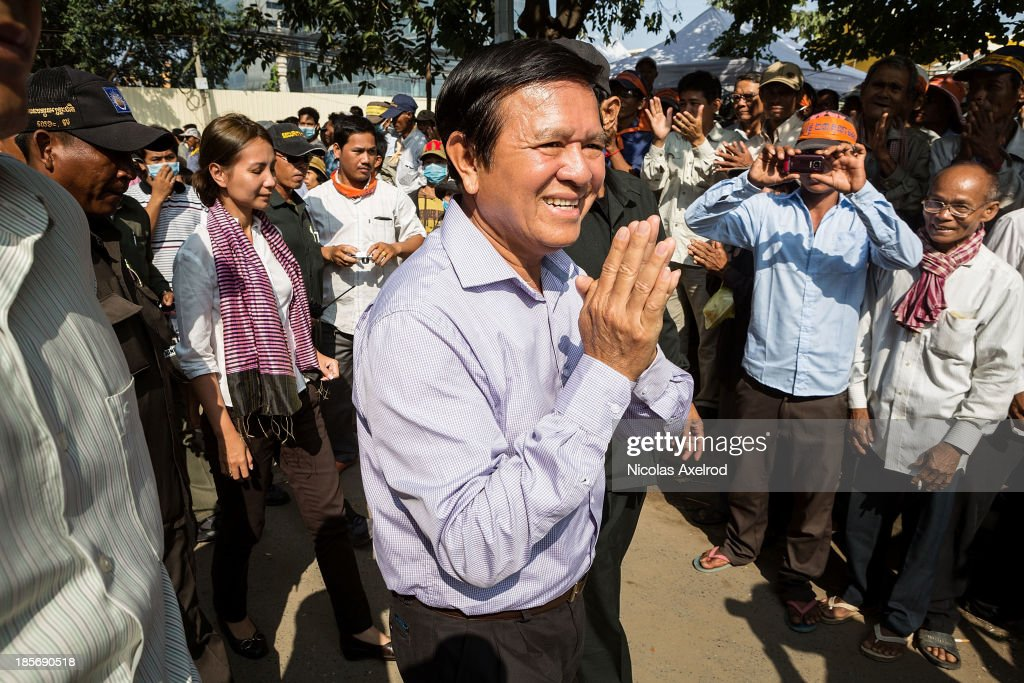 <a gi-track='captionPersonalityLinkClicked' href=/galleries/search?phrase=Kem+Sokha&family=editorial&specificpeople=659005 ng-click='$event.stopPropagation()'>Kem Sokha</a> (C) Vice-President of the CNRP arrives at Freedom Park to lead a march to the French embassy on October 24, 2013 in Phnom Penh, Cambodia. The Cambodian National Rescue Party held their second day of a three day protest in commemoration of the 22nd anniversary of the October 23, 1991 Paris Peace Accords. The CNRP delivered letters to the French, US, and British embassies asking them to pressure the Cambodian government to resolve the current political deadlock caused by a dispute over the country's July elections.
