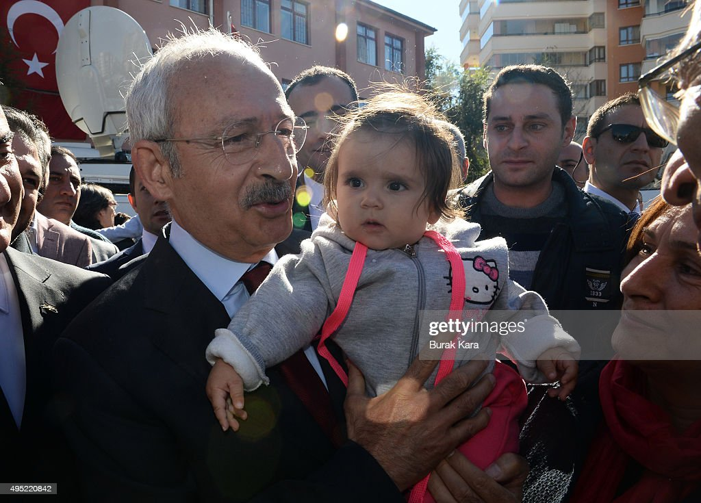 <a gi-track='captionPersonalityLinkClicked' href=/galleries/search?phrase=Kemal+Kilicdaroglu&family=editorial&specificpeople=7129513 ng-click='$event.stopPropagation()'>Kemal Kilicdaroglu</a>, leader of the main opposition Republican People's Party (CHP) holds a child after casting his vote at a polling station during a general election on November 1, 2015, in Ankara, Turkey. Polls have opened in Turkey's second general election this year, with the ruling Justice and Development Party (AKP) hoping to win a majority, as the country searches for stability amongst serious security concerns.