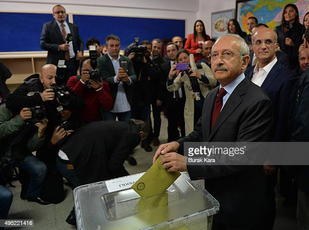 Kemal Kilicdaroglu leader of the main opposition Republican People's Party casts his vote at a polling station during a general election on November...