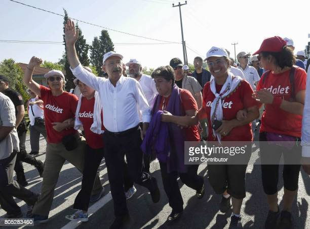 Kemal Kilicdaroglu leader of Turkey's main opposition Republican People's Party walks with thousands of supporters and Ihsan Eliacik leader of...